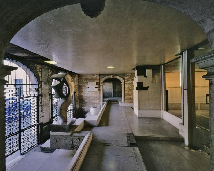 Fondazione Querini Stampalia renovations, Venice, 1961-63, view across water entry room from entrance hall, with the water gates (l) and radiator enclosure and glass wall (r) (picture: Gianantonio Battistella © CISA- A. Palladio)